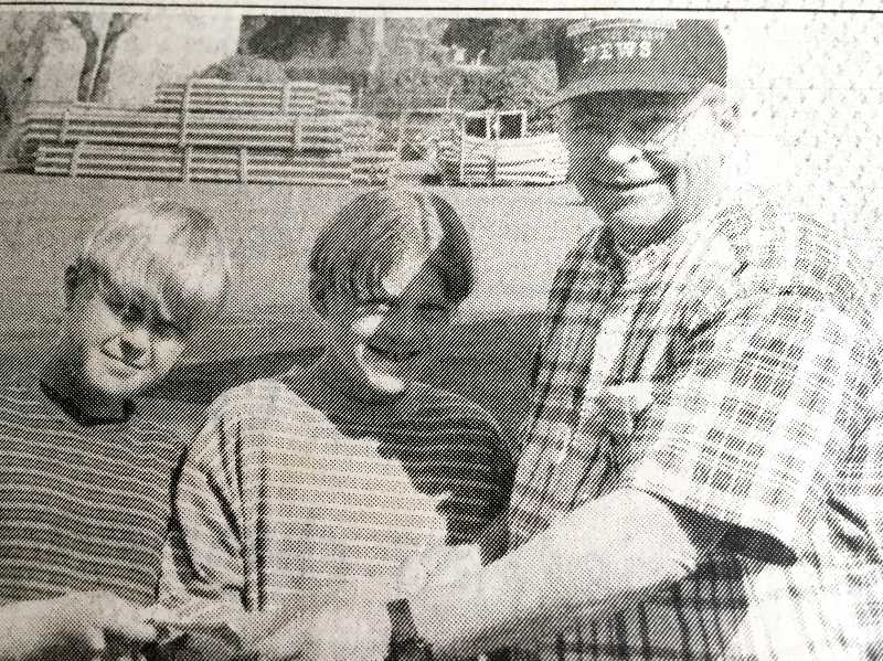 ARCHIVE PHOTO - In 1997, News Publisher Bill James presented  Kyle and Garrett Gilstad with $20 each as a reward for returning a large sum of money they found at the Estacada Market.