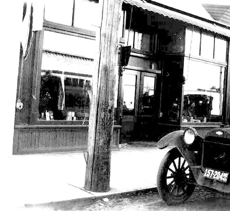 "PIONEER FILE PHOTO - William Mackrell's Harness Shop on South Molalla Avenue in about 1913, where Mr. Mackrell ran Molalla's first lending library, a ""reading room"" and a collection of books. According to a Nov. 6, 1930 article in the Capital Journal,  he updated the collection by sending select books to Salem Library once every six months and receiving ""a completely new library."""