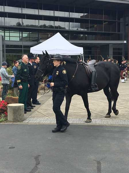 COURTESY OF SHERWOOD CITY MANAGER JOE GALL  - A riderless horse is escorted during a ceremony held May 2 in Salem in honor of slain Seaside Officer Jason Goodding during the Oregon Public Safety Academy's annual Fallen Law Enforcement Officers Memorial ceremony.