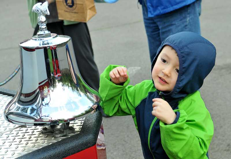 REVIEW PHOTO: VERN UYETAKE - Max Lee has fun ringing the bell on a Lake Oswego fire engine during the Emergency Preparedness Fair, which also included a Junior Firefighter obstacle course.