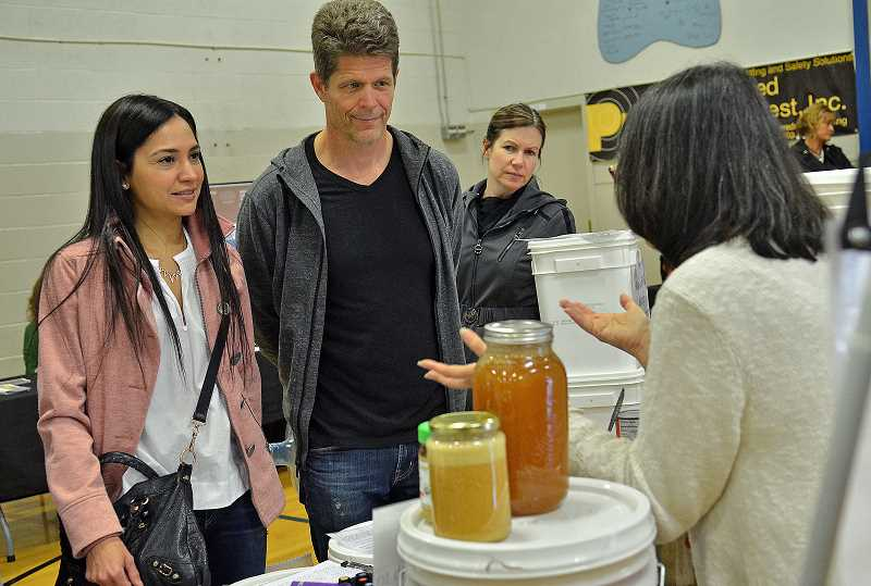 REVIEW PHOTO: VERN UYETAKE - Greg and Olga Carlson learn about options for storing whole foods in case of an emergency during last week's Emergency Preparedness Fair.