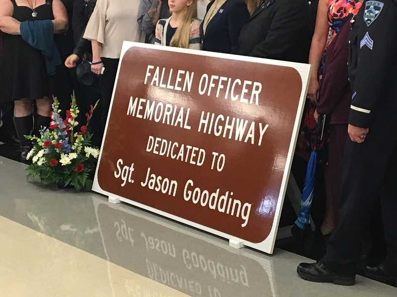 COURTESY OF SHERWOOD CITY MANAGER JOE GALL - A new Oregon highway plaque was unveiled May 2 in Salem containing the name of Seaside Police Officer Jason Goodding who was killed in the line of duty in Seaside in February 2016. Sherwood representatives attending the ceremony included Mayor Krisanna Clark, Police Chief Jeff Groth, Police Capt. Mark Daniel and City Manager Joe Gall.
