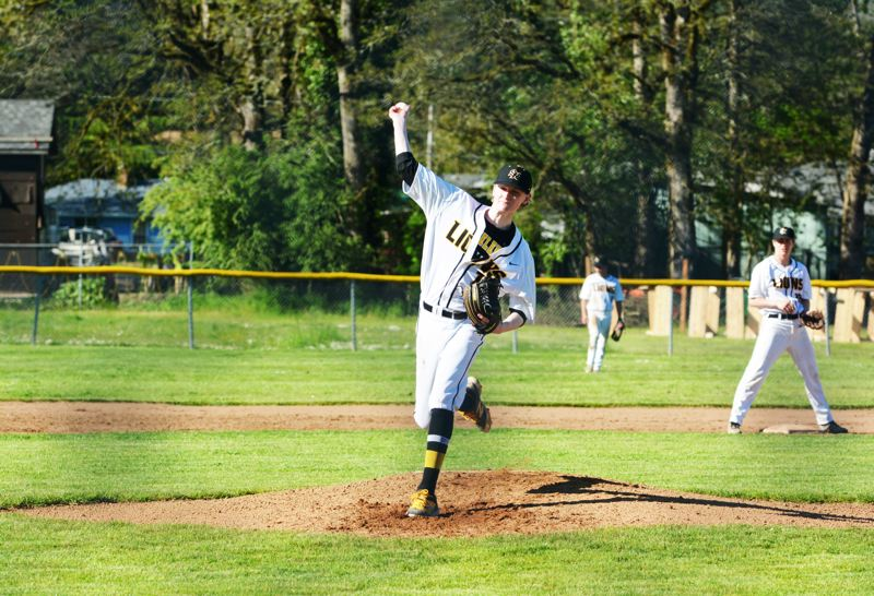 SPOTLIGHT PHOTO: JAKE MCNEAL - Indians junior Owen Wolfe releases a pitch in a 4-3 loss to Sandy on Wednesday in St. Helens.