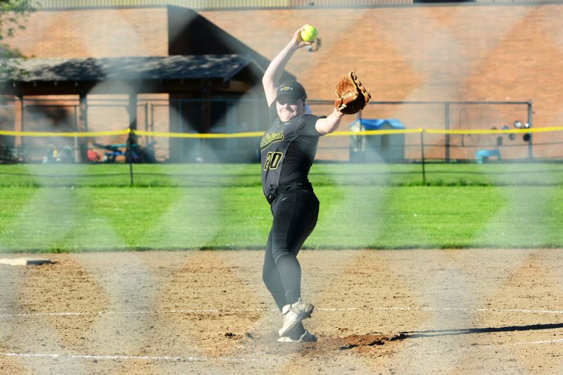 SPOTLIGHT PHOTO: JAKE MCNEAL - Lions senior Brooklynn Scheer delivers a pitch in an 8-4 win over Parkrose on Wednesday in St. Helens.
