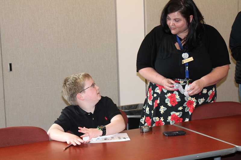 TIDINGS PHOTO: PATRICK MALEE - Youth Services Librarian Rebecca Mayer showed kids how to take and analyze fingerprints at a recent CSI Club meeting.