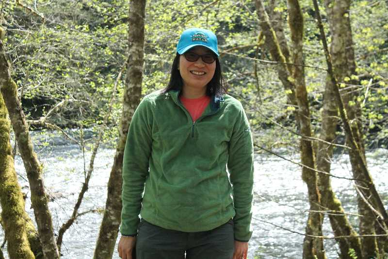PIONEER PHOTO: CONNER WILLIAMS - Asako Yamamuro, the new executive director of Molalla River Watch, at last weekend's Molalla River Cleanup.