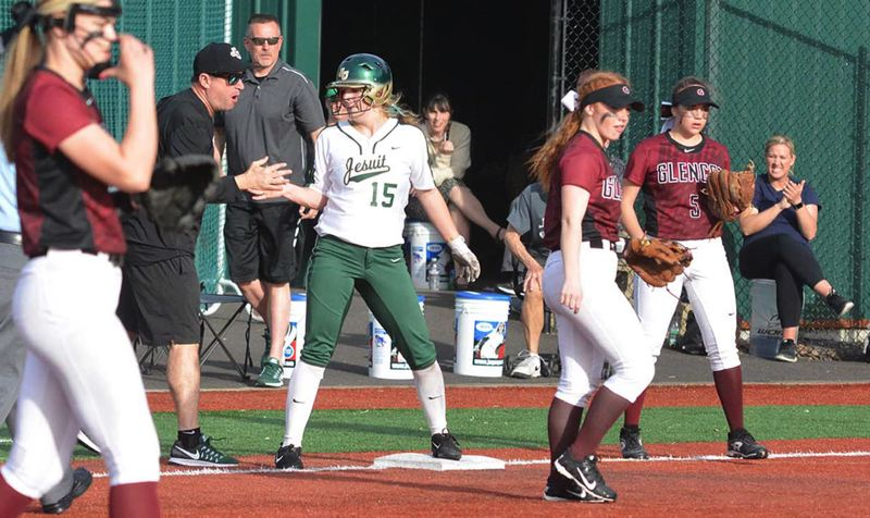 PMG PHOTO: MATT SINGLEDECKER - Jesuit's Annalisa Williamson accepts congratulations from coach Jim Speciale during their recent game with Glencoe. The Crusaders are currently top-ranked in Class 6A softball.