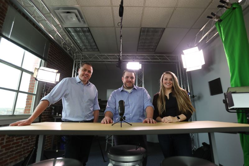 PAMPLIN MEDIA GROUP: JAIME VALDEZ - Daniel O'Connell, Chris Hertzog and Deej Savage pose on the wrong side of the video desk for a Business Tribune photo, but might be on the right side of history when it comes integrating video into messaging and commerce.
