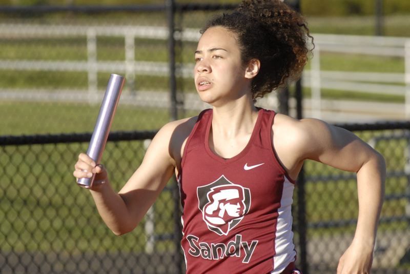 SANDY POST: MATT RAWLINGS - Sandy's Athena Thomas runs the second leg in the 4X400 relay