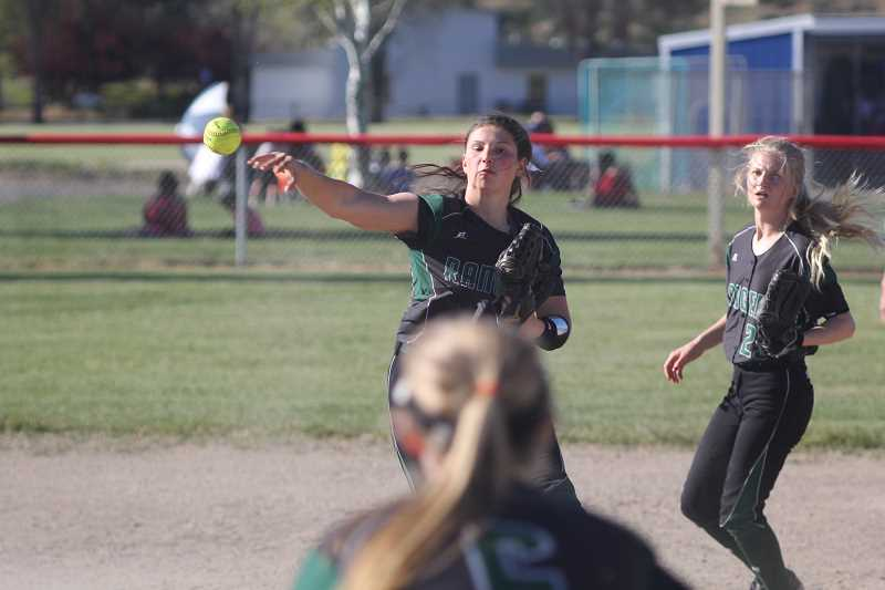 WILL DENNER/MADRAS PIONEER - Despite several early defensive blunders, Estacada gutted out a win with heads up defense. Here, Estacada shortstop Skylar Hunter throws out a Madras runner at first base.