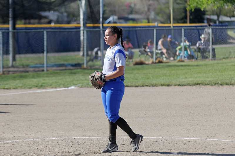 WILL DENNER/MADRAS PIONEER - Seldom a pitcher this season, Madras senior Jordan Patt was called on to replace starter Lizzie Steuart in the top of the second inning. Although she needed some time to identify the strike zone, she and the Madras defense twice got out of bases loaded jams to end the inning.