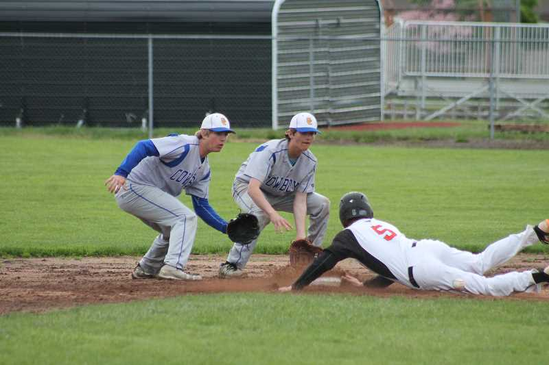 PIONEER PHOTO: CONNER WILLIAMS  - Molalla senior Aaron Alexander steals second and slides into the base safe during the Indians' 11-1 win over Crook County Friday on senior night.