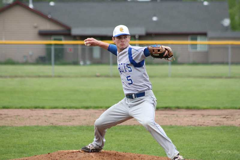 PIONEER PHOTO: CONNER WILLIAMS  - Crook County junior Heath Pickhardt delivers a pitch during the Cowboys' 11-1 loss to Molalla Friday.