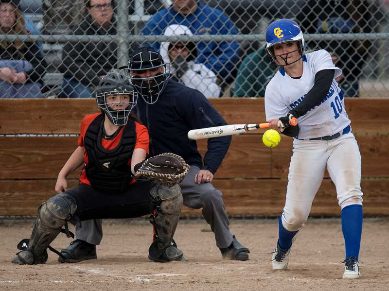 LON AUSTIN/CENTRAL OREGONIAN - Ashley Owens drives in a run with one of her three hits against the Molalla Indians on Friday. Crook County won the game 10-0, clinching the league championship.