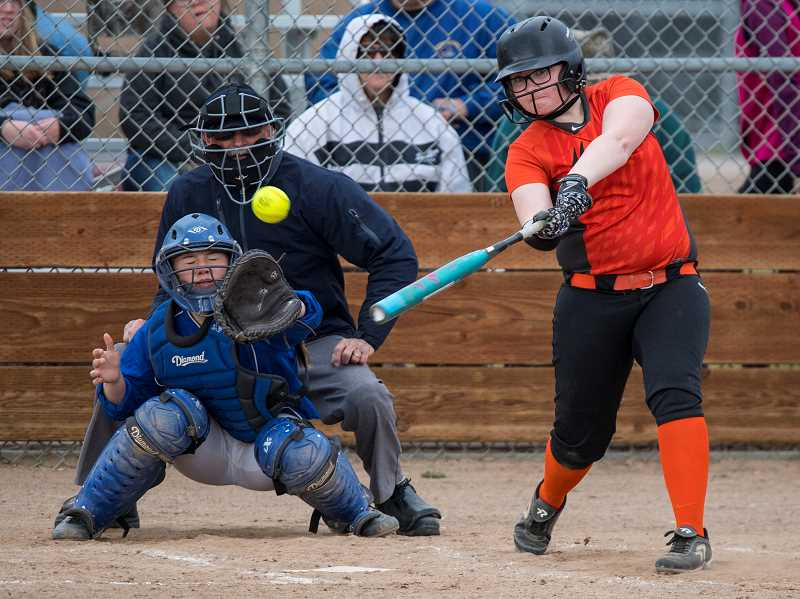 LON AUSTIN/CENTRAL OREGONIAN - Brittni Callahan picks up one of her two hits in the Indians' loss to Crook County on Friday.