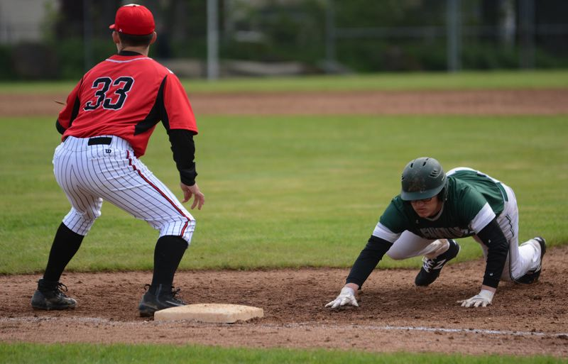 OUTLOOK PHOTO: DAVID BALL - Reynolds Ben Patterson dives safely back to first base during the teams 6-1 road loss to Oregon City on Friday.