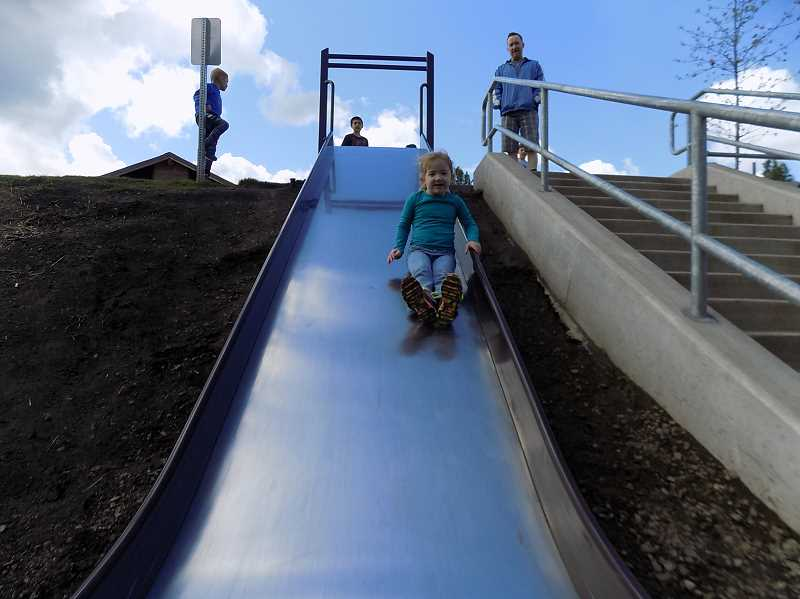 GAZETTE PHOTO: RAY PITZ - Charlyn Peters, 4, tries out the new slide at Woodhaven Park May 6 just before the park celebrated its grand reopening.