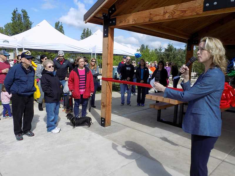 GAZETTE PHOTO: RAY PITZ  - Mayor Krisanna Clark talks about what efforts it took to bring the remodeled Woodhaven Park to fruition during a grand reopening on May 6.