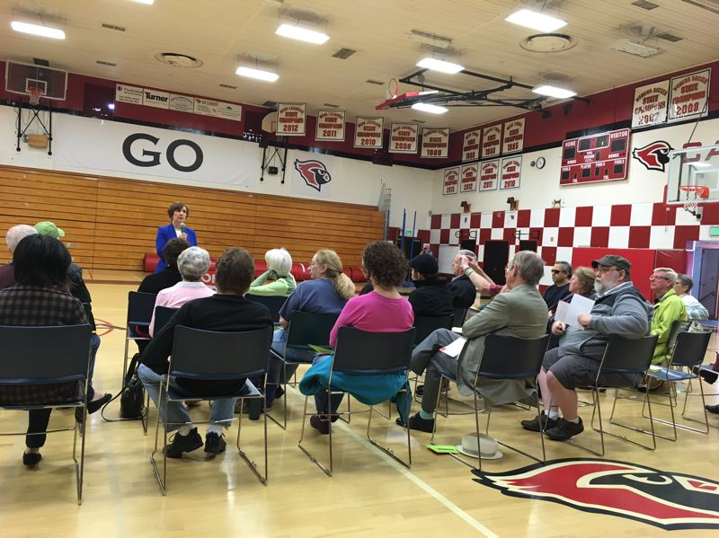 PAMPLIN MEDIA GROUP: PETER WONG - U.S. Rep. Suzanne Bonamici, D-Beaverton, speaks at a town hall meeting Sunday (May 7) in the Lincoln High School gym in Portland.