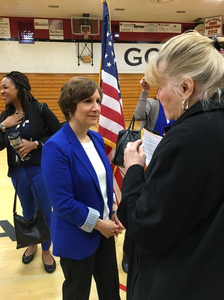 PAMPLIN MEDIA GROUP: PETER WONG - U.S. Rep. Suzanne Bonamici, D-Beaverton, meets a constituent after her town hall meeting Sunday (May 7) at Lincoln High School gym in Portland