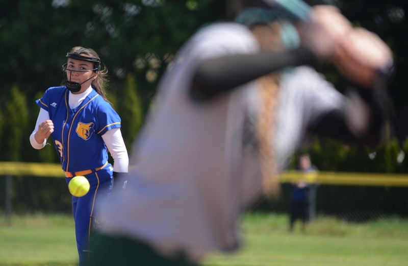 OUTLOOK PHOTO: DAVID BALL - Barlow pitcher Alexia Geary sends a throw to the plate against Reynolds' hitter Alison Walton during the Bruins' 5-3 win Saturday.