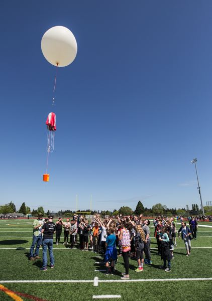 TIMES PHOTO: JONATHAN HOUSE - Fifth-graders from Edward Byrom Elementary School cheer as students from the Oregon Institute of Technology in Wilsonville test-launch a balloon from the football field at Tualatin High School.