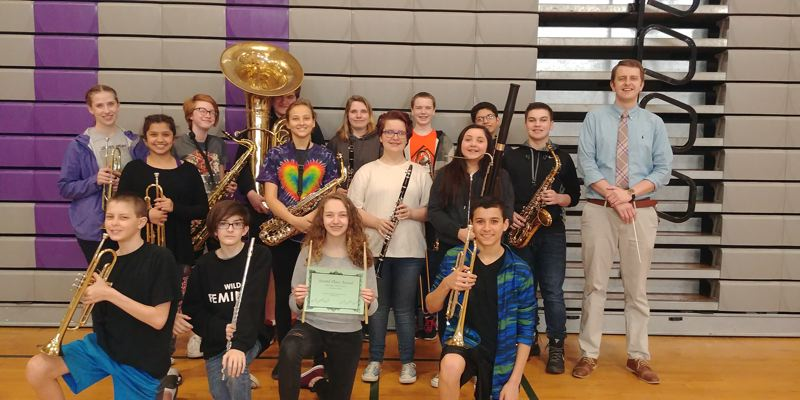 Teacher Seth Arnold directs Kraxberger Middle School's eighth-grade band, which took second place at the Baker Prairie Band Festival.