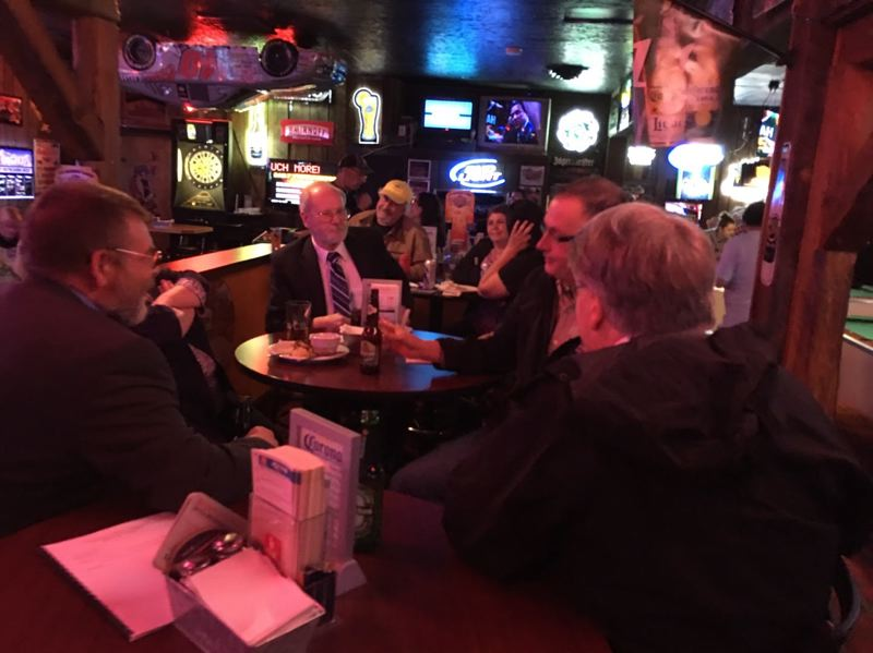 PHOTO BY: GREG ALEXANDER - A resident of Gladstone took this photo showing Gladstone City Councilors Kim Sieckmann (from left), Thomas Mersereau, Patrick McMahon and Steve Johnson (back to camera) meeting in Vogies Bar at approximately 9:30 p.m., after an April 25 City Council meeting.