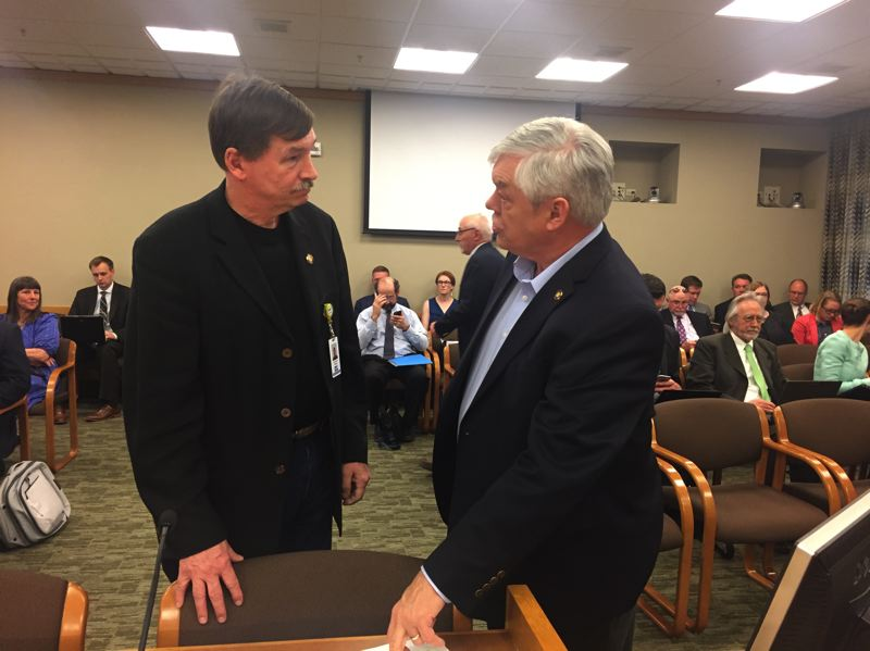 PARIS ACHEN/CAPITAL BUREAU - Left to right, Sens. Brian Boquist, R-Dallas, and Lee Beyer, D-Springfield, talk at the Oregon Capitol Monday, May 8, 2017, before their presentation on a transportation package lawmakers will consider this session.