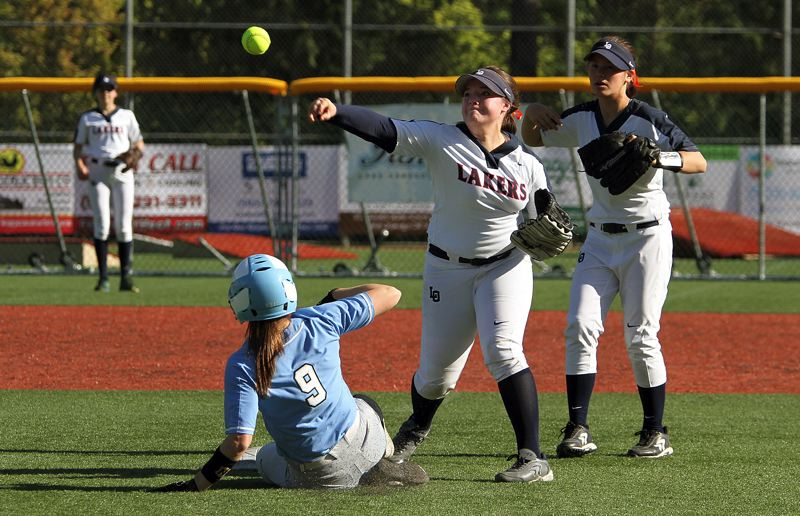 REVIEW PHOTO: MILES VANCE - Lake Oswego shortstop Morgan Jones tries to turn a double play with Lakeridge's Kelley Ericson sliding into second base during the Lakers' 9-5 home win on Monday.
