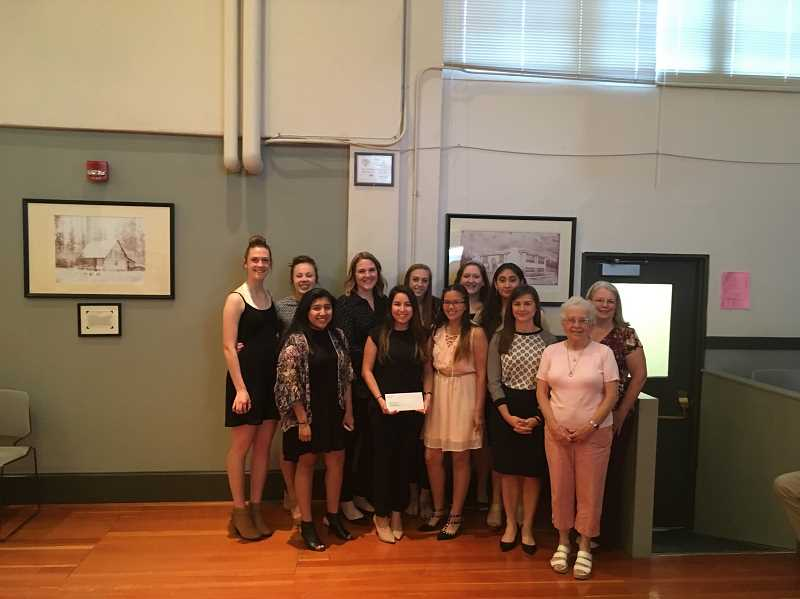 COURTESY PHOTO - Banks High School leadership class students gathered Monday evening, May 8, to hand over money to representatives of the Forest Grove-based nonprofit Adelante Mujeres.