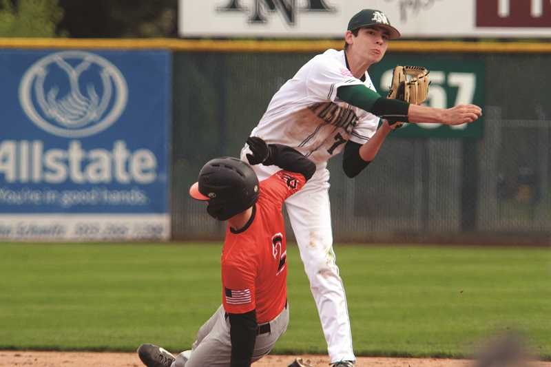 PHIL HAWKINS - North Marion sophomore Grant Henry turns a double play in the Huskies' 10-4 win over Yamhill-Carlton on Friday. Henry finished the game with two runs scored and a team-best two RBIs.