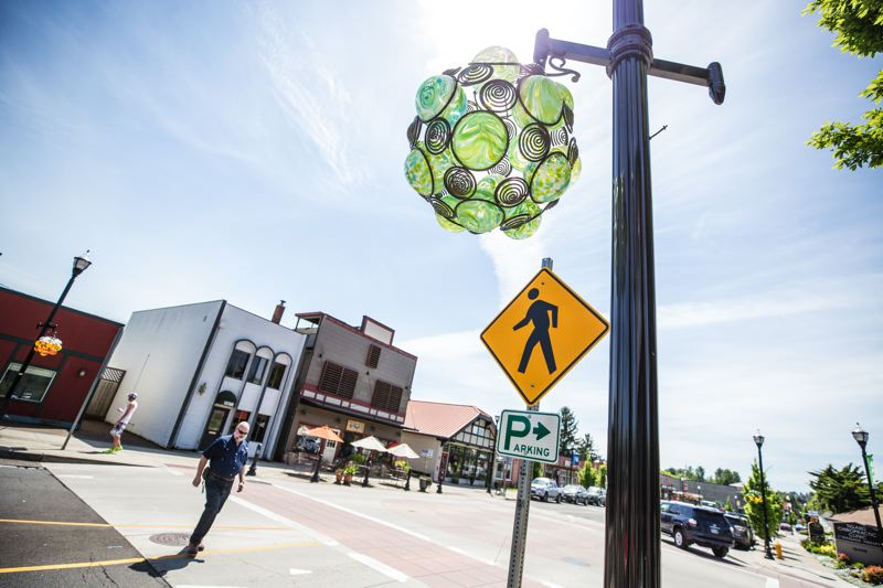 TIMES PHOTO: JONATHAN HOUSE - Glass baskets like this one adorn Main Street in Tigard, much the same way that hanging flower baskets do in places like downtown Beaverton.