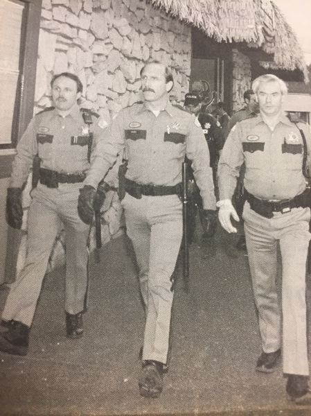 ARCHIVE PHOTO - Police officers prepare to enter the Safari Club during a gambling raid in the late 1980s.