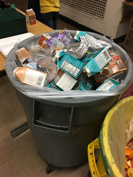 TRIBUNE PHOTO: JENNIFER ANDERSON - Milk cartons can take up a lot of space in the school cafeteria trash when theyre not recycled.