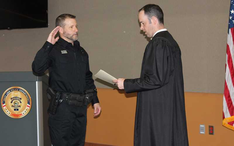TIDINGS PHOTO: PATRICK MALEE - Glenn Howard, a former deputy at the Washington County Sheriff's Office, was sworn in as West Linn's newest police officer Thursday, May 4.