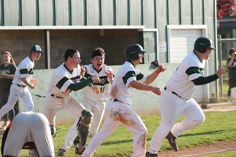PIONEER PHOTO: CONNER WILLIAMS  - Estacada charges the field after senior Levi Albrecht's walk-off single in the bottom of the eighth to secure the second Tri-Valley title in a row for the Rangers after beating Molalla 3-2 in extra innings Tuesday.