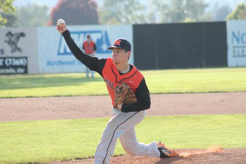PIONEER PHOTO: CONNER WILLIAMS  - Molalla senior pitcher Aaron Alexander delivers a pitch during the Indians' 3-2 loss to Estacada in extra innings Tuesday for the Tri-Valley title. Alexander recorded ten strikeouts on the evening.
