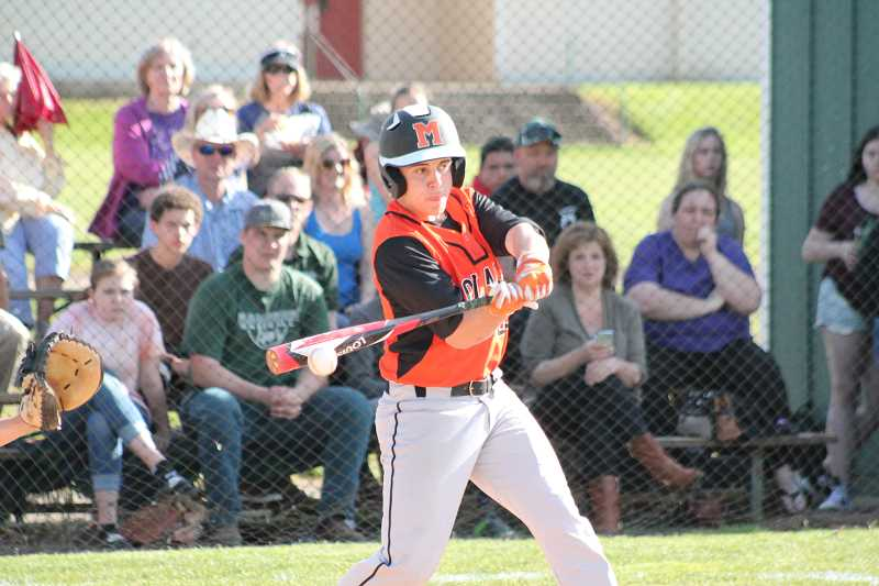 PIONEER PHOTO: CONNER WILLIAMS  - Molalla freshman Damian Pingo makes contact during the Indians' 3-2 loss to Estacada in extra innings Tuesday for the Tri-Valley title.