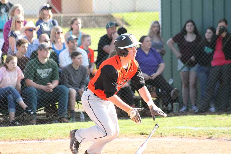 PIONEER PHOTO: CONNER WILLIAMS  - Molalla junior Braden Hibbs sprints for first after smashing a two-RBI double in the top of the third inning to put Molala up 2-0 during the Indians' 3-2 loss to Estacada in extra innings Tuesday for the Tri-Valley title.