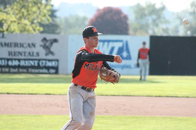 PIONEER PHOTO: CONNER WILLIAMS  - Molalla senior Aaron Alexander makes the throw to first base during the Indians' 3-2 loss to Estacada in extra innings Tuesday for the Tri-Valley title.