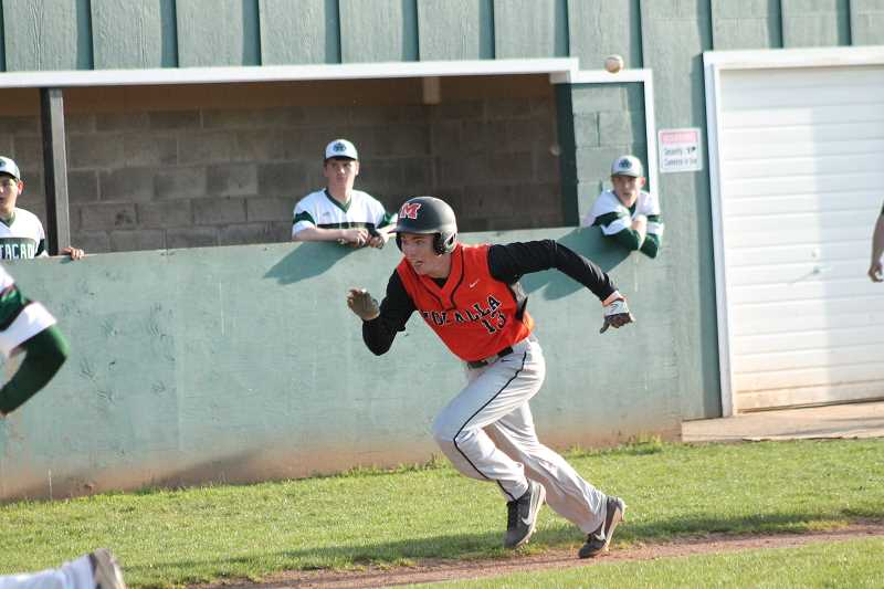 PIONEER PHOTO: CONNER WILLIAMS  - Molalla sophomore Jeff Larsen takes off for home after being caught in a pickle in the top of the eighth during the Indians' 3-2 loss to Estacada in extra innings Tuesday for the Tri-Valley title.
