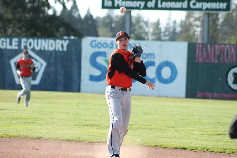 PIONEER PHOTO: CONNER WILLIAMS  - Molalla sophomore Jeff Larsen makes a throw to first base during the Indians' 3-2 loss to Estacada in extra innings Tuesday for the Tri-Valley title.