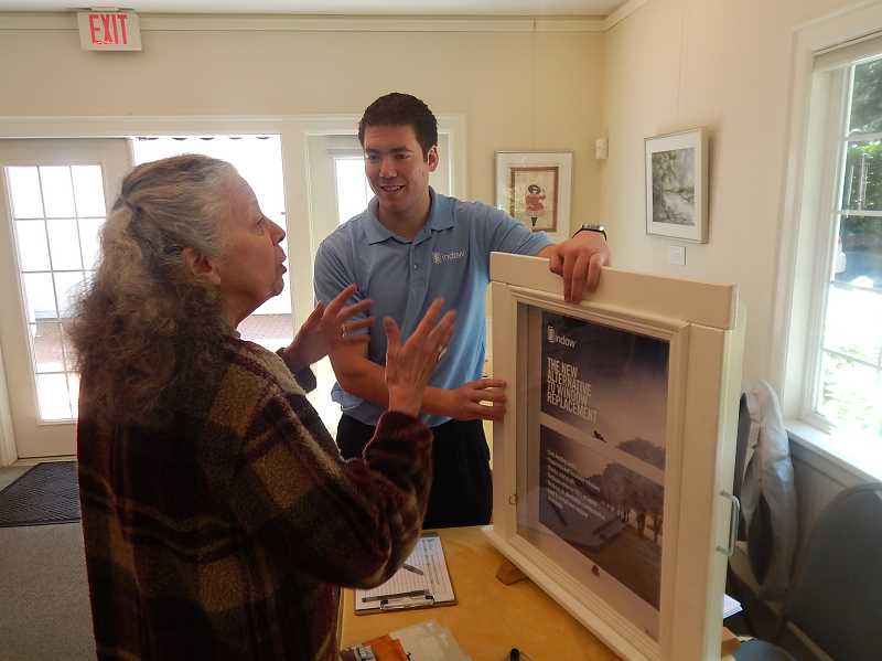 REVIEW PHOTO: ANTHONY MACUK - Lake Oswego resident Meg James discusses window rehabilitation options with Tyler Johnson of Portland-based Indow Windows. James said she came to the expo to learn more about window options for her 1926 home.