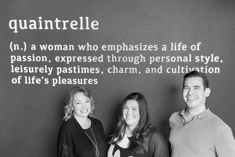 SUBMITTED PHOTOS: AUBREY LEGAULT - From left, Sandi Wilkens, Emily Everett and Daniel Wilkens, the owners of Quaintrelle restaurant on Mississippi Avenue pose by the sign in the restaurant that explains the name.