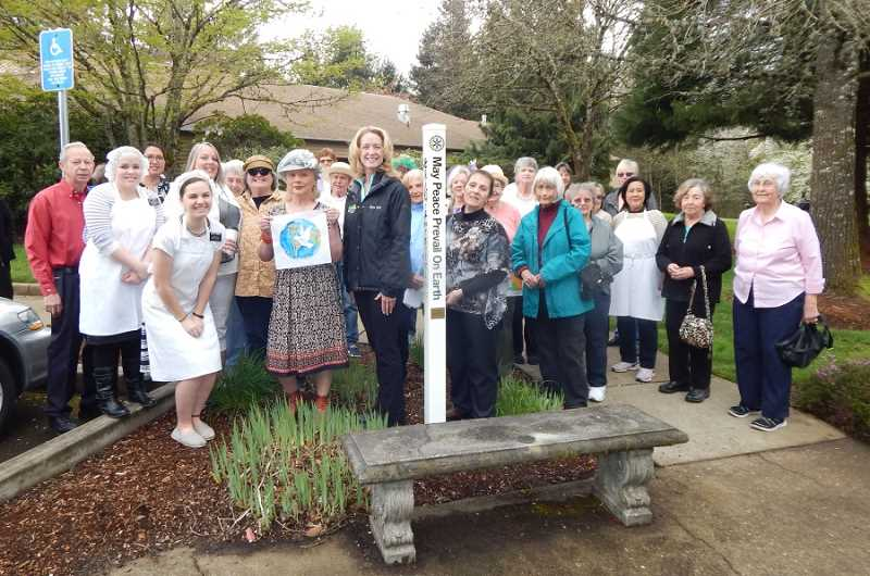BARBARA SHERMAN - A good-sized crowd gathered at the Marjorie Stewart Community/Senior Center on April 14 to dedicate another peace pole provided by the Sherwood Rotary Club.
