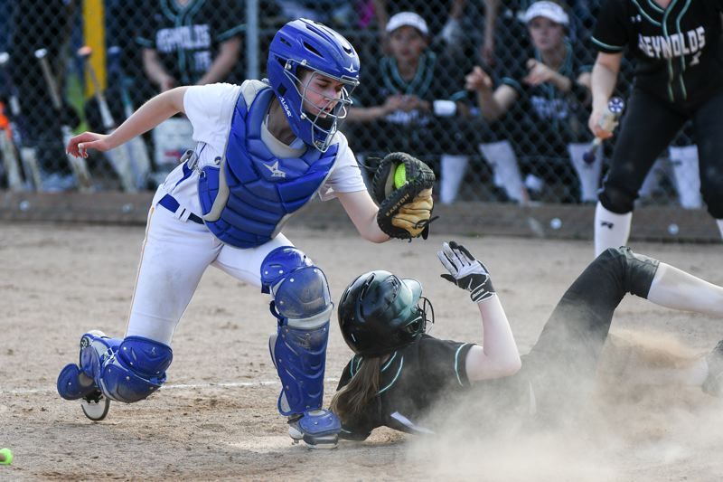 OUTLOOK PHOTO: JOSH KULLA - Barlow catcher Sarah Gernhart is late with the tag as Reynolds sophomore Megan Convery scores Wednesday, but it was too little, too late for the Raiders, as they fell to the Bruins 12-2 in five innings in Mt Hood Conference softball.