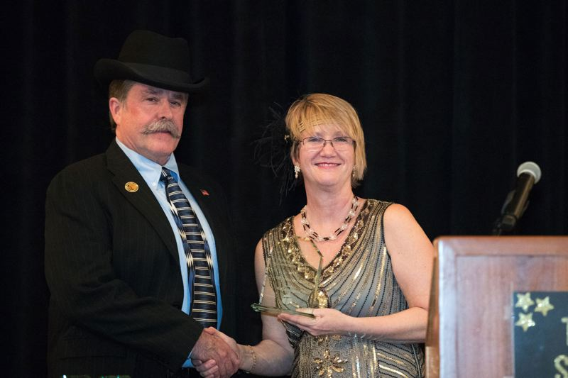 TIMES PHOTO: JAIME VALDEZ - Leadership Tigard might inspire you to emulate Ralph Hughes, left, seen here receiving a Shooting Star award from Tigard Chamber of Commerce CEO Debi Mollahan last month for his work as chairman of a Chamber advocacy committee.