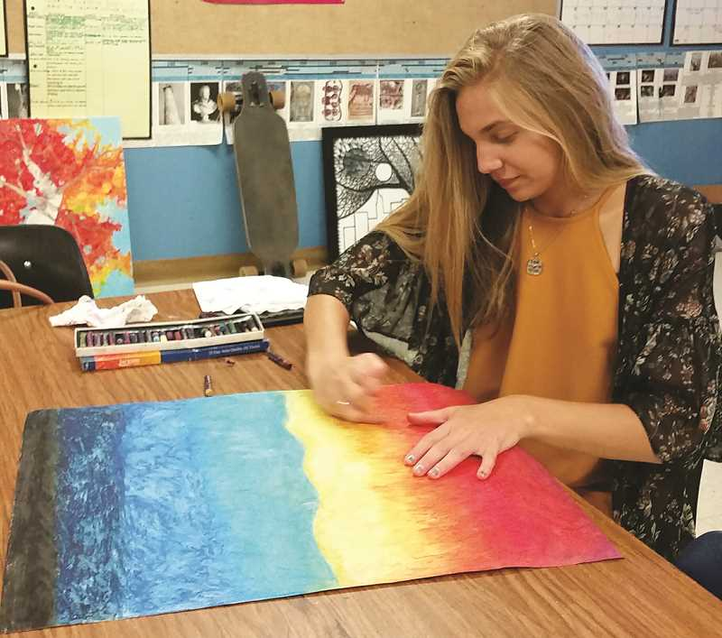 ALISSA TRAN - Molalla HIgh School art student Hannah Allegretto puts the finishing touches on her artwork.