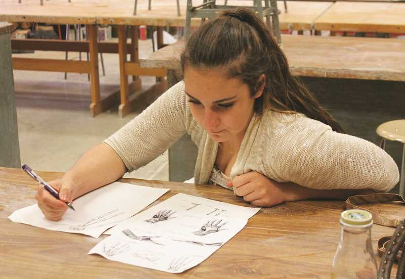 CONNER WILLIAMS  - A student working on a pencil sketch in the MHS Art Department